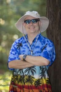 Portrait of Marc Jedel in another Hawaiian shirt and unfortunate hat