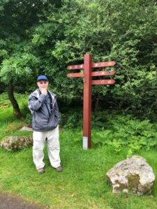 Marc standing in front of confusing signpost