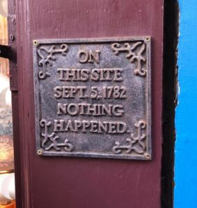 "Sign on door that says ""on this site in Sept 5, 1782, nothing happened."""