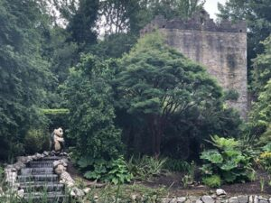 Castle garden with statue of panda in middle